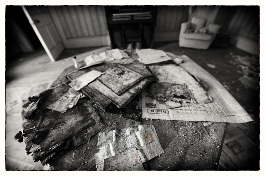 Documents on a table in abandoned Manor House B