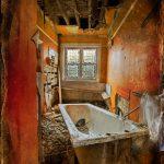 Bath in orange bathroom, texture overlay,derelict house in Streatham, South London, UK